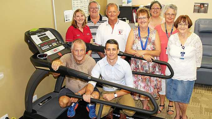 IMPORTANT: Patient Ken Fry and exercise physiologist Tim Parker, (standing, from left) clinical nurse Leisa Lowry, former patient Brian Clarke, patient John Lawson, Auxiliary president Kerry Rose, former patient Denise Campbell, treasurer Jenny McLeod and secretary Margaret Pope.