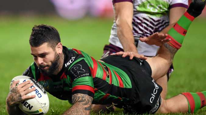 Adam Reynolds of the Rabbitohs scores a try.