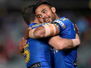 Bevan French (right) of the Eels is congratulated by Michael Gordon after scoring a try.