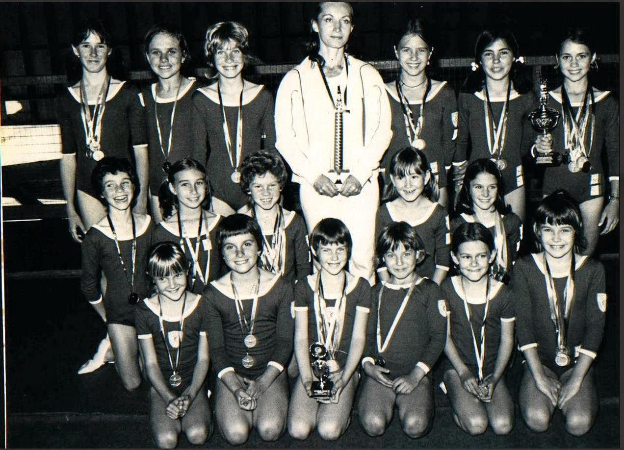 MENTOR: Mrs T with GGC gymnasts in the early years.