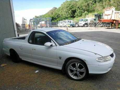 A white Holden Commodore going up for auction.