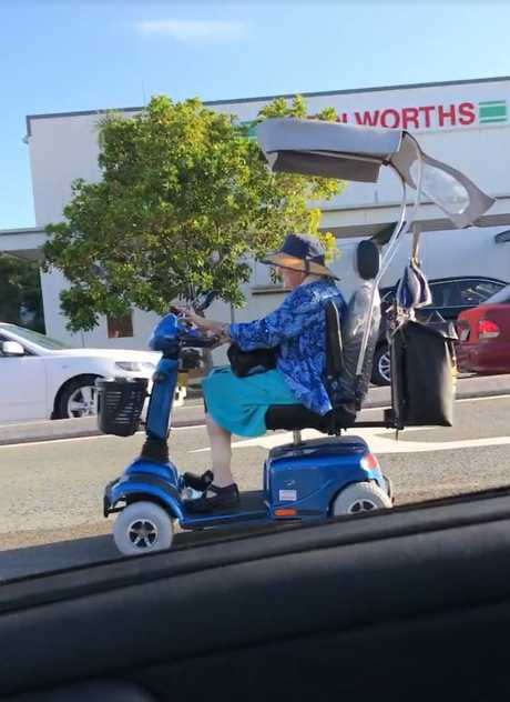 AN ELDERLY woman held up traffic on a busy Coast road, driving her mobility scooter down the centre lane.