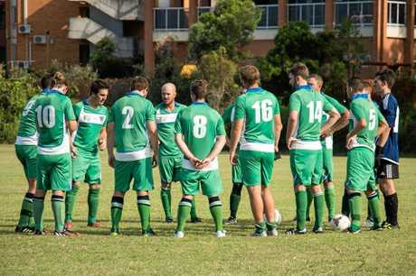 TEAM TALK: Maclean Bobcats come together on field around captain Jarred Doyle during a recent trial fixture against Murwillumbah FC.