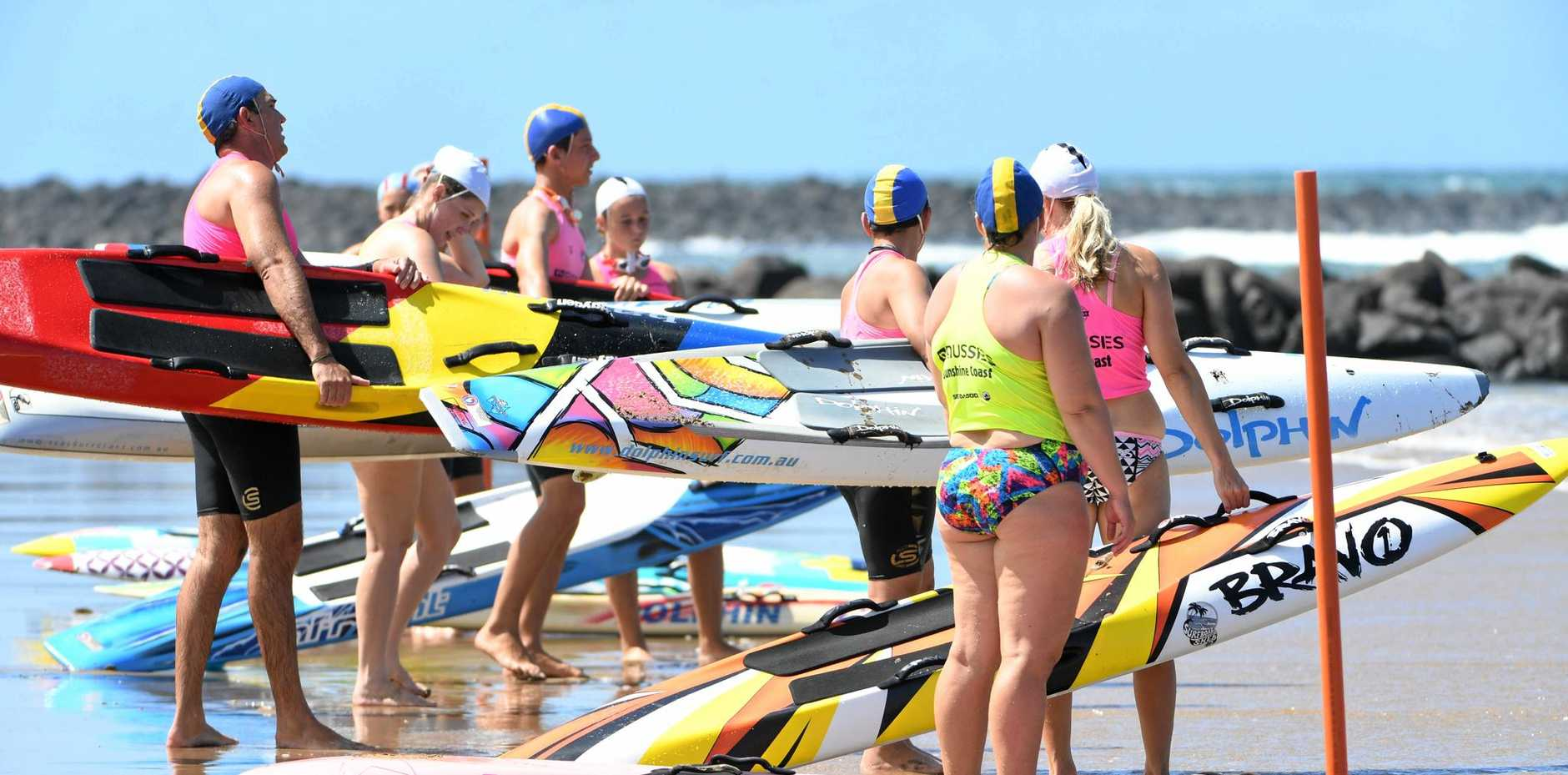 READY TO RACE: Competitors line up at a recent surf rescue event.