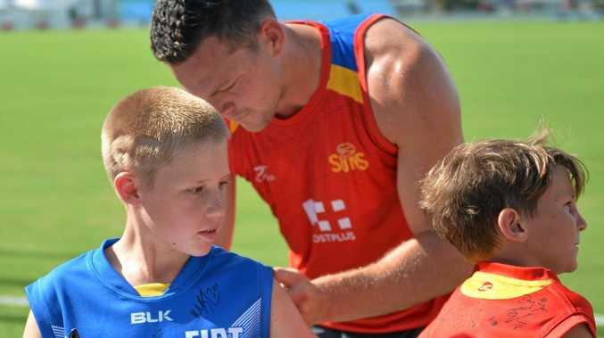 Xavier Bone meets Gold Coast Sun's Stephen May.