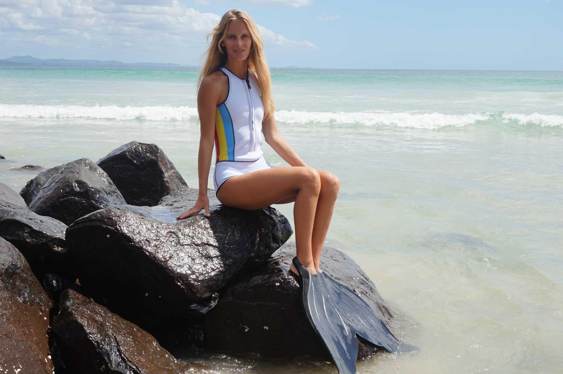 Abysse swimwear co-director Hanalei Reponty models local brand mermaid flippers by Mahina Mer-Fins. Photo by Alina Rylko.