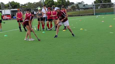 Savannah Fitzpatrick and Shane Kenny teaching the under 15 girls tackling techniques