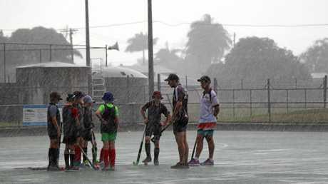 Troy Elder coaching the under 13 boys in the rain.