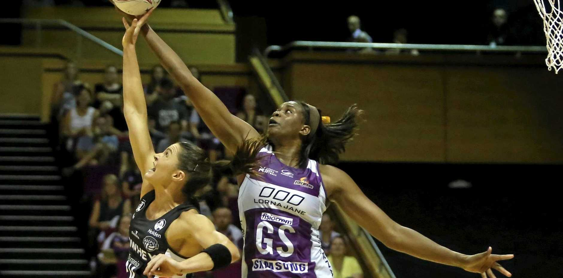 Romelda Aiken battles with Sharni Layton at the Brisbane Entertainment & Convention Centre.