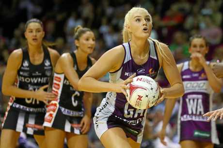 Gretel Tippett of the Firebirds passes during the