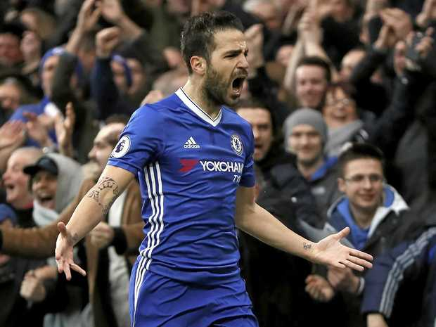 Chelsea's Cesc Fabregas celebrates after he scores a goal in the win over Swansea City.