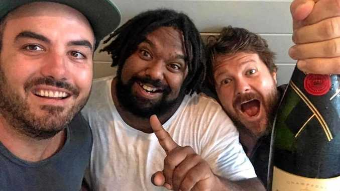The boys Jeremy Marou and Thomas Busby celebrate their ARIA #1 with manager Josh Jones