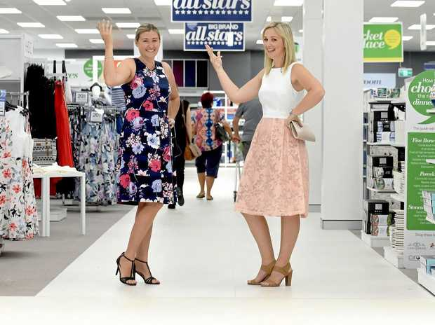 ON THE WAY: Marney Rackley and Ashlea Gessell from Harris Scarfe display the latest fashions that can be purchased when the Rockhampton store opens later this year.