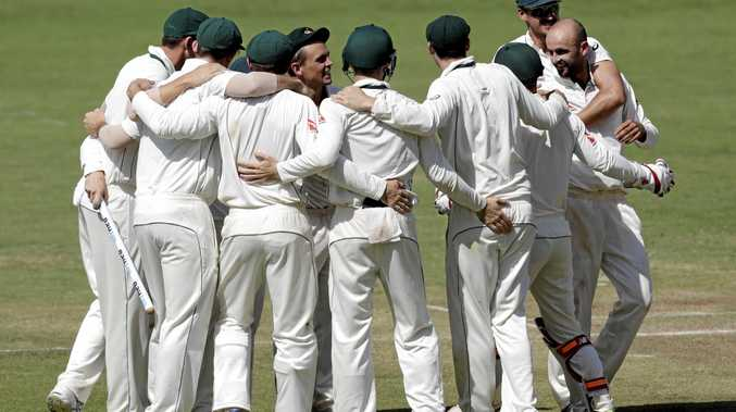 Australia's Steve O'Keefe, center, and teammates celebrate after winning the first cricket test match against India in Pune.