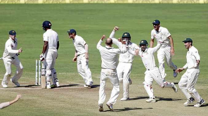 GREAT WIN: Australia's captain Steve Smith (left) leads the celebration after his side beat India in the First Test in Pune.