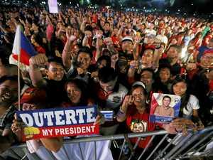 Duterte's hardline war on drugs splits protesters in Philippines