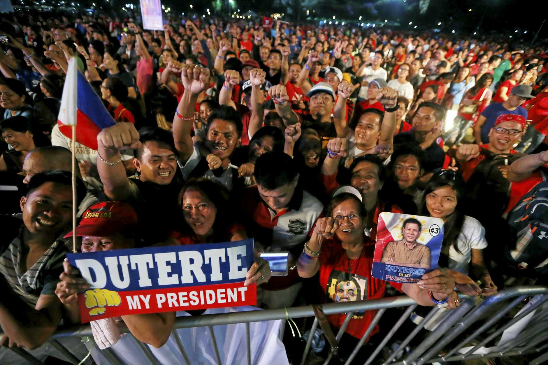 Supporters of President Rodrigo Duterte gather at Manila's Rizal Park for an overnight vigil to show their support for the President's so-called war on drugs.