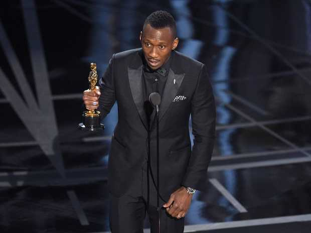 Mahershala Ali accepts the award for best actor in a supporting role for Moonlight at the Oscars on Sunday, Feb. 26, 2017, at the Dolby Theatre in Los Angeles.