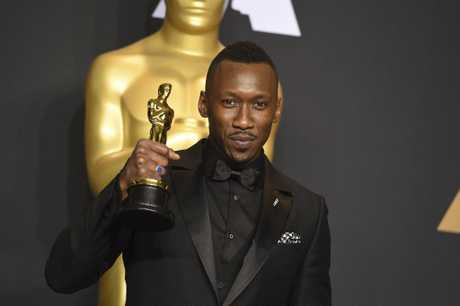 Mahershala Ali poses in the press room with the award for best actor in a supporting role for \