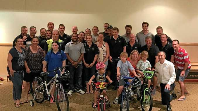 Mackay Base Hospital patients Midjah 'Daisy' Parnaby, 11, Cooper Watson, 4, and Hamish and Noah Gonnella, 7, with their donated bikes. They're pictured with chair of the Mackay Hospital Foundation board Michael Jones (far right) and Clermont Coal employees.