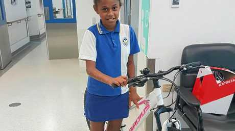 Mackay Base Hospital patient Keiarna David, 11, with her new bike donated by Clermont Coal employees, facilitated by the Mackay Hospital Foundation.