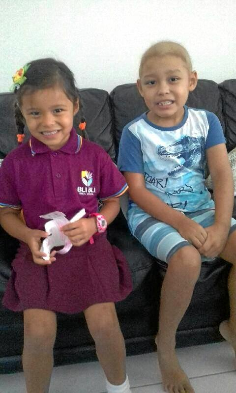 Fighter: Micah Murdoch, 6, with his sister Maya. Micah is fighting leukemia for the second time, but he desperately needs a bone marrow transplant.