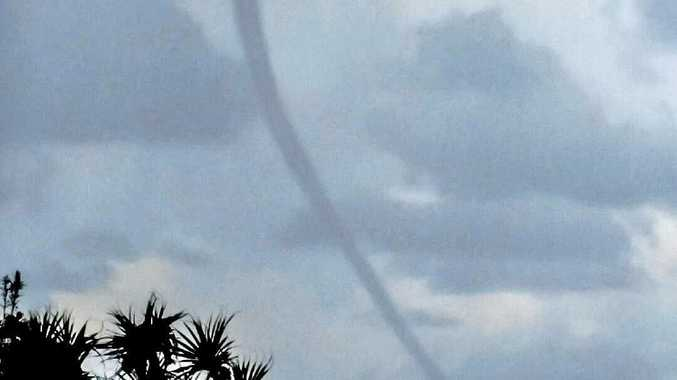 As the weather starts to turn to rain, Travis Armstrong snapped this photo of a waterspout that appeared over Main Beach at Minnie Water on Sunday.