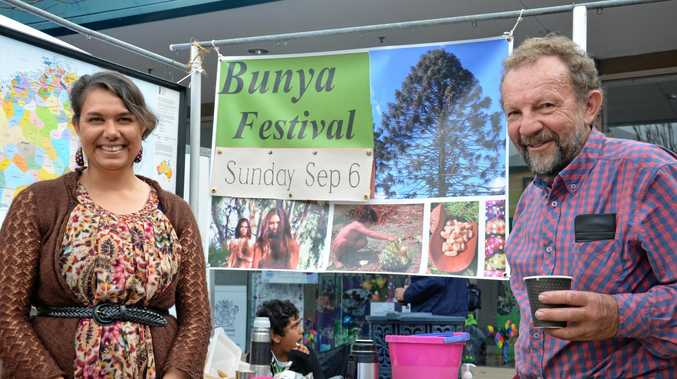 PROUD IDENTITY: Sharman Parsons with father David Parsons at the Bunya Festival stall during Jumpers and Jazz.