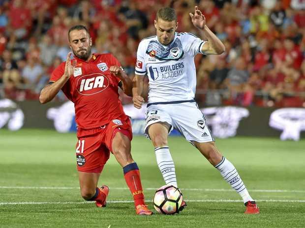 Tarek Elrich (left) in action against Melbourne Victory.