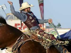 HOLDING ON: Warwick cowboy Michael Maher rides Big Mumma.