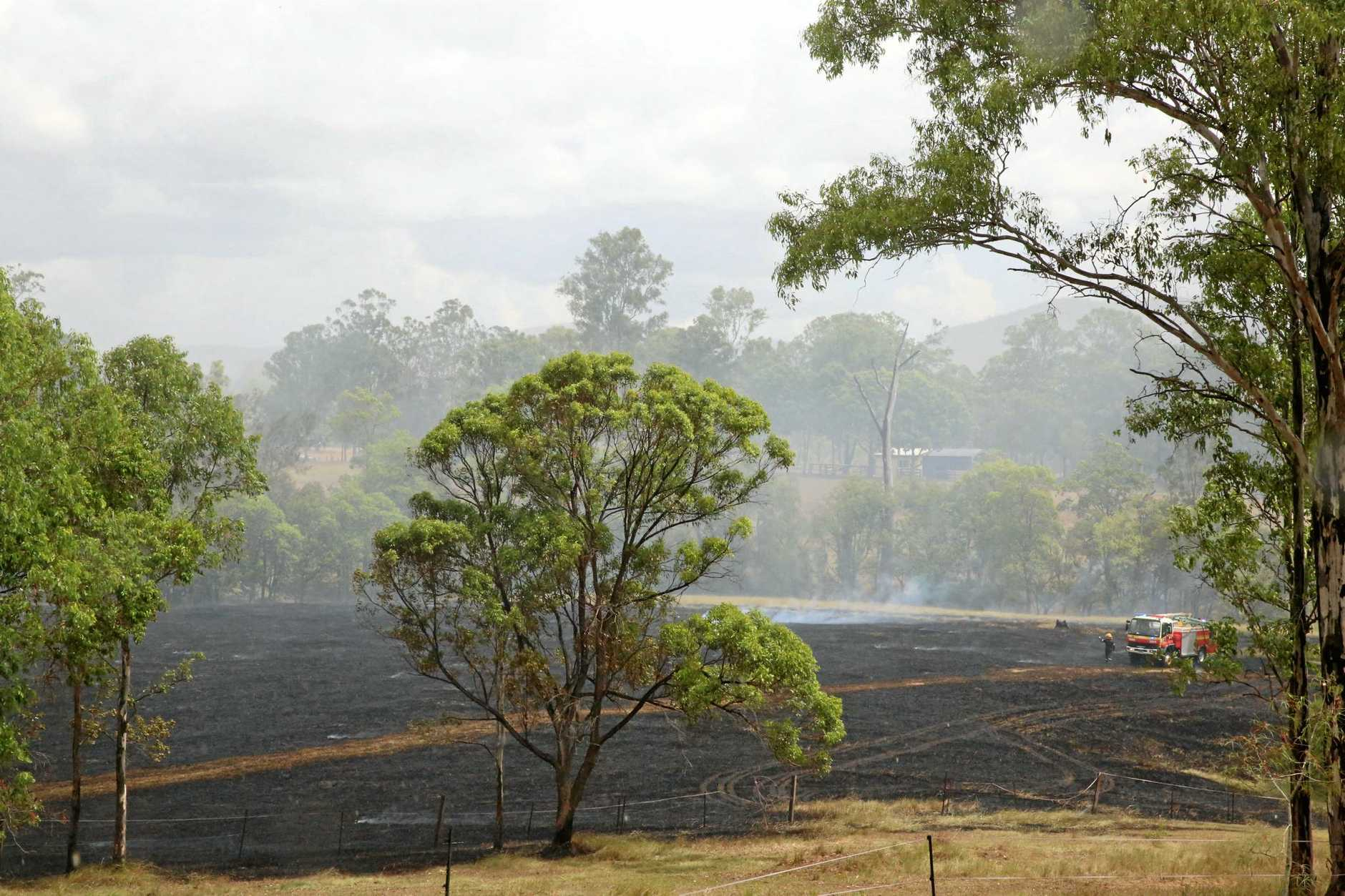 BLACKENED EARTH: Emergency crews extinguished a grass fire at Danchia Court, Southside.