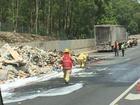 ROAD BLOCK: Emergency workers clean up Western Freeway truck fire. Contributed by Mitchell Carr.