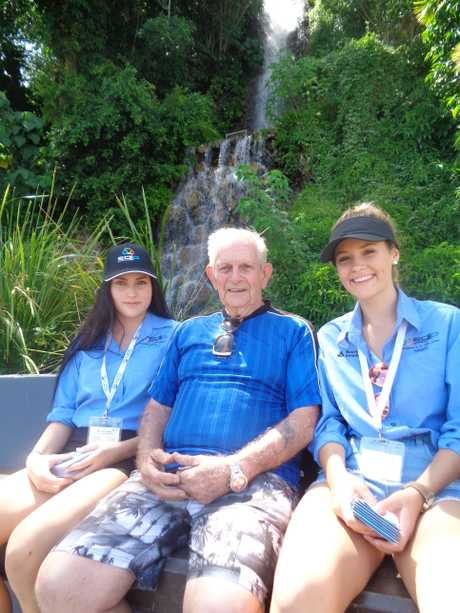 OLD-TIMER: Tannum Sands State High School students Porcia and Hannah met and chatted with Fred Critchley.