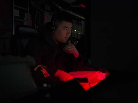 An Operations Specialist watches a radar display aboard the USS Coronado operating in the South China Sea. The ability to 'see' stealth aircraft largely negates their threat.