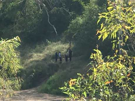 Police search the banks of the Calliope River for missing mum Hannah Cook.