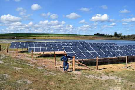 SHINE ON: Isis cane grower John Russo with the solar panels he has installed to power his centre pivot irrigation system.