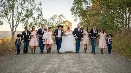 FARMER FAMILY: Madalyn and Jesse Barrett with their wedding party.