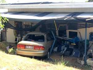 Car crashes into fence, home