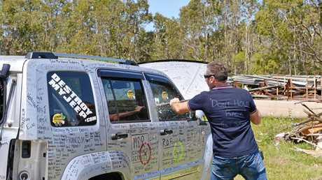 DESTROY MY JEEP: Ashton Wood destroys his Jeep to raise awareness of vehicle lemon laws.  Photo: John McCutcheon / Sunshine Coast Daily