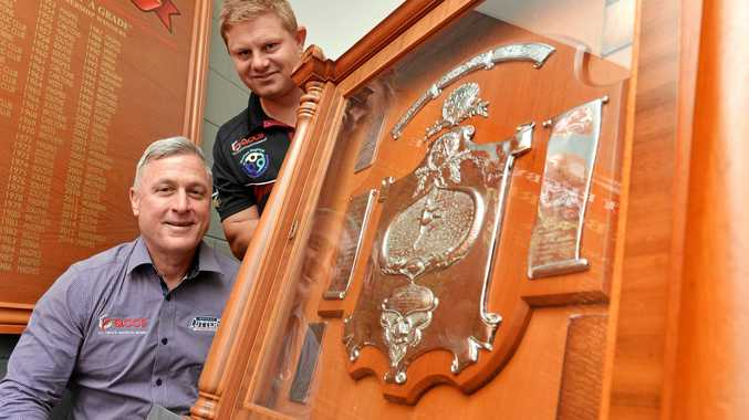 Cutters CEO Troy Rovelli (front) and Cutters coach Steve Sheppard with the Foley Shield.