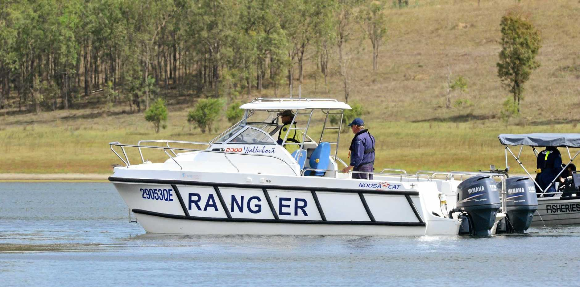 SES and Police search for a missing person at Wivenhoe Dam.