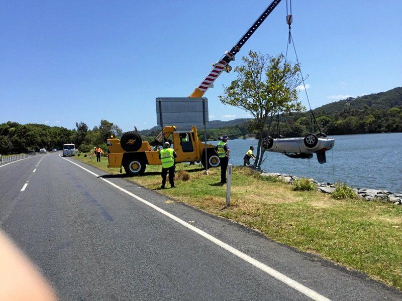 Emergency services pull a Mazda coupe, which crashed into the Tweed River on Tweed Valley Way on Sunday night, from the water on Wednesday afternoon.