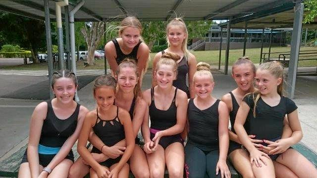 OFF TO TITLES: (Back row, from left) Lucy Samin, Laurn Meredith, (front row, from left) Chelsea Humphreys, Ula Weir, Zali Allison, Emma Finn, Lily Sleeman, and Lu-Mari Appelgrijn with her sister Chris-Lynn Appelgrijn on her lap.