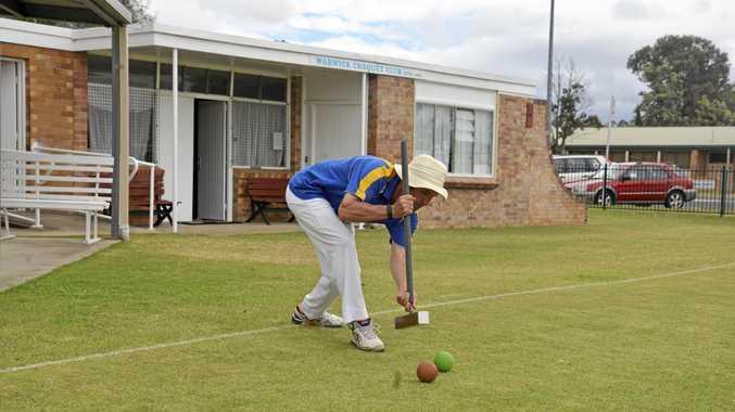 PRECISION HIT: Warwick Croquet Club president Sean Hegarty follows through after a shot on the club lawns.