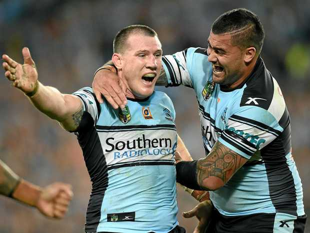 Paul Gallen and Andrew Fifita of the Sharks celebrate following their team's win over the Storm in the NRL grand final.