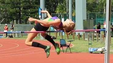 Erica Tillman clearing the bar competing in high jump