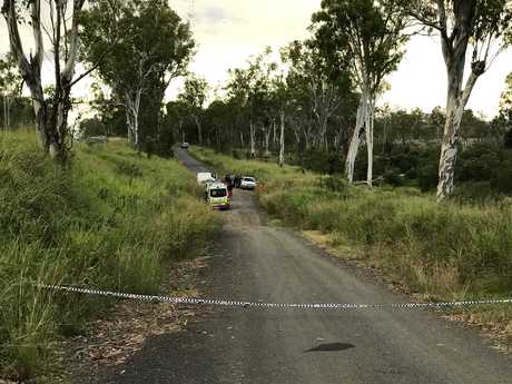TRAGIC: Paramedics arrive at the scene to recover the body of Hannah Cook.