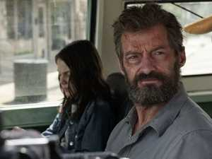 Dafne Keen and Hugh Jackman in a scene from the movie Logan.