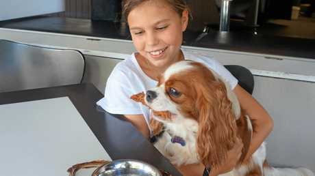 Matilda Timbs, 9, enjoying posing with her pooch at The Italian Diner, Bangalow, which offers a menu for dogs. Dogs eat on the pavement only.