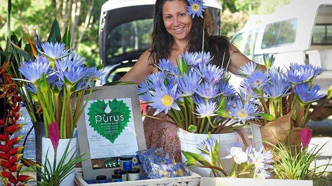 LOTUS POSITION: Mullumbimby Farmers Market stallholder Liz Lualdi with her blue lotus flowers.